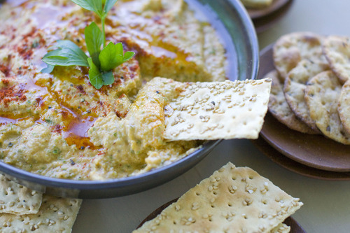 Garlic adds punch to this grilled zucchini hummus recipe. (Associated Press photo by Matthew Mead)