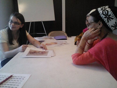 ESLC emergent reader students attending a class at a South Salt Lake partnership location taught by Catharine Preston (left), ESLC Instructor. Courtesy | English Skills Learning Center