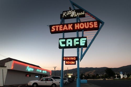 Rick Egan  | The Salt Lake Tribune   Neon lights the sky outside the local landmark that is the Kitty Pappas Steak House on Highway 89 in Woods Cross.