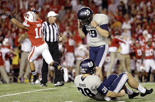 Wisconsin's Devin Smith (10) reacts after Utah State kicker Josh Thompson (19) missed a field goal attempt in the final seconds of an NCAA college football game Saturday, Sept. 15, 2012, in Madison, Wis. Wisconsin won 16-14. (AP Photo/Morry Gash)