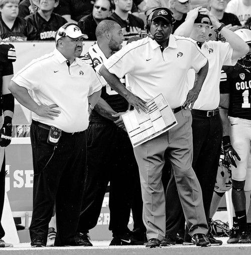 Colorado head coach Jon Embree, center, watches from the sideline Morgan during the second half of an NCAA college football game against Colorado State, Saturday, Sept. 1, 2012, in Denver. Colorado State won 22-17. (AP Photo/The Daily Camera, Jeremy Papasso) NO SALES