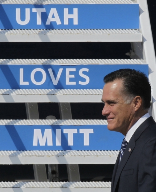 Republican presidential candidate and former Massachusetts Gov. Mitt Romney arrives at Salt Lake City International Airport during a visit to Utah for a pair of fundraisers Tuesday, Sept. 18, 2012, in Salt Lake City.  (AP Photo/Rick Bowmer)