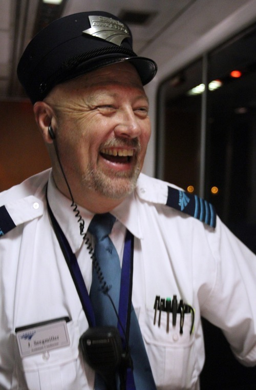 Rick Egan  | The Salt Lake Tribune   Jay Seegmiller has a laugh in the lounge car after the train pulls out of Provo, Monday, September 10, 2012.  Seegmiller,    Amtrak train conductor, has spent 35 years working on railroads. Now he's running for Utah's 2nd Congressional seat.