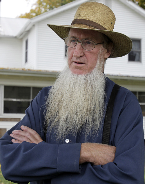 Sam Mullet Sr. stands in the front yard of his home in October 2011 in Bergholz, Ohio. Mullet was convicted Thursday of hate crimes in beard- and hair-cutting attacks.