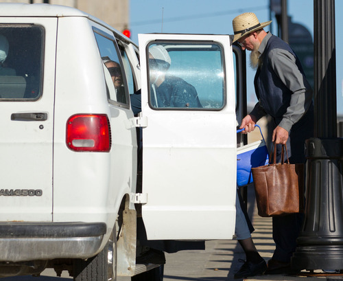 An Amish man boards his transportation outside the U.S. Federal Courthouse in Cleveland on Wednesday, Sept. 19, 2012.  The jury finished their fourth day of deliberations without a verdict in the trial of 16 people accused of hate crimes in hair- and beard-cutting attacks against fellow Amish in Ohio. (AP Photo / Scott R. Galvin)