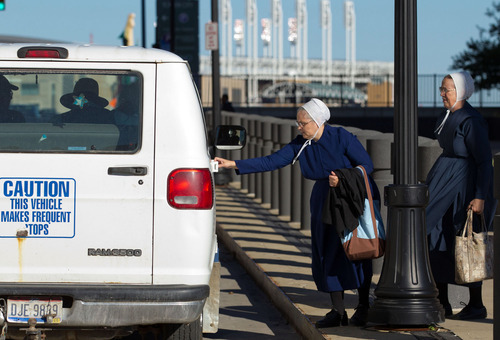 Amish women leave the U.S. Federal Courthouse in Cleveland on Wednesday, Sept. 19, 2012. The jury finished their fourth day of deliberations without a verdict in the trial of 16 people accused of hate crimes in hair- and beard-cutting attacks against fellow Amish in Ohio. (AP Photo / Scott R. Galvin)