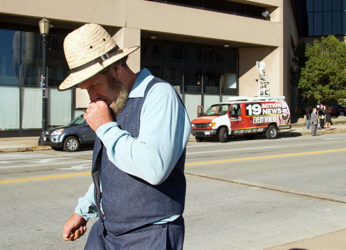 An Amish man leaves the U.S. Federal Courthouse in Cleveland on Wednesday, Sept. 19, 2012.  The jury finished their fourth day of deliberations without a verdict in the trial of 16 people accused of hate crimes in hair- and beard-cutting attacks against fellow Amish in Ohio. (AP Photo/Scott R. Galvin)