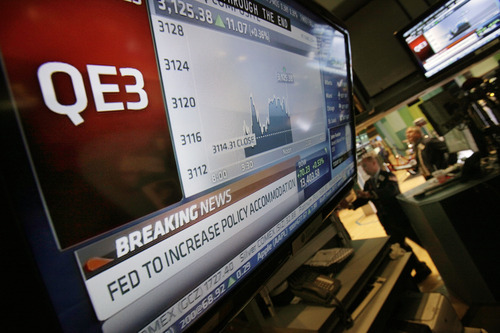 (AP Photo/Richard Drew) Rising wealth could give Americans more confidence in the economy, a key goal of the bond-buying plan, known as QE3, the Federal Reserve unveiled last week. The Fed hopes to drive interest rates down and stock prices up.