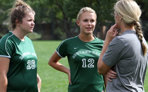 Rick Egan  | The Salt Lake Tribune   Rowland Hall soccer players Cari Sanyer (left) and Grace Veghte(right) talk to head coach Jamie Wilhite, Monday, September 10, 2012.