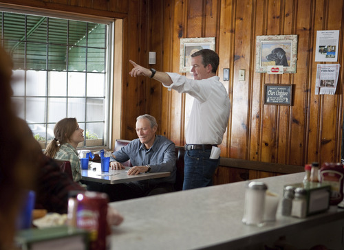 Director Robert Lorenz (right) confers with stars Amy Adams and Clint Eastwood on the set of the baseball movie
