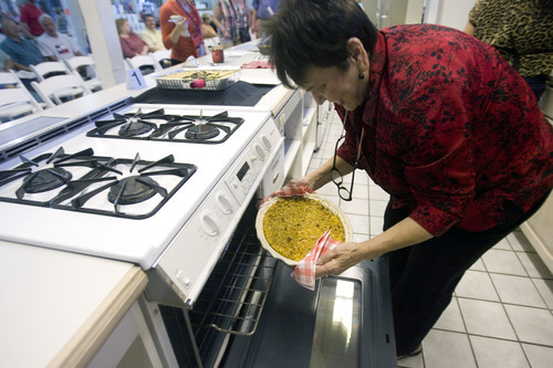 Kim Raff | The Salt Lake Tribune Nancy Judd takes her entry out of the oven before judging begins in the Funeral Potato Contest at the Utah State Fair last week.
