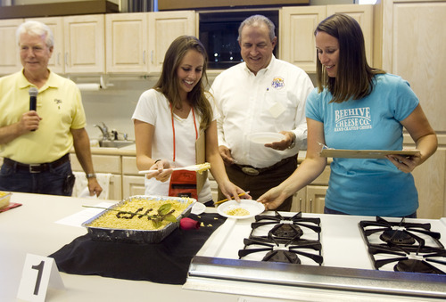Kim Raff | The Salt Lake Tribune Judges (from left) Katie Johnson, Kyle Stephens and Carrian Cheney judge the first entry in the Funeral Potato Contest at the Utah State Fair in Salt Lake City earlier this month.