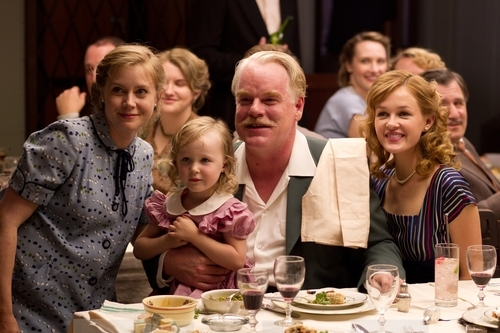 This film image released by The Weinstein Company shows Amy Adams, left, and Philip Seymour Hoffman, center, in a scene from