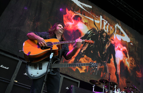 Steve Griffin   The Salt Lake Tribune   Staind guitarist, Mike Mushok's, plays two guitars on the main stage at the Uproar Festival at the Usana Amphitheatre in South Jordan, Utah Wednesday September 19, 2012.
