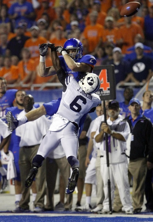 Boise State wide receiver Matt Miller misses a high pass on 4th down defended  by BYU defensive back Jordan Johnson Thursday Sept. 20, 2012 at Bronco Stadium in Boise.