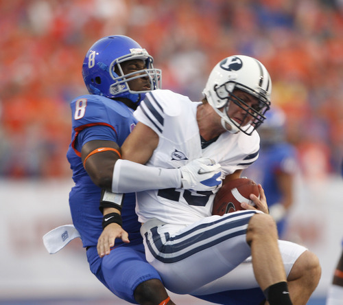 Boise State defensive end Demarcus Lawrence sacks Riley Nelson #13 of the BYU Cougars at Bronco Stadium on Thursday September 20, 2012.