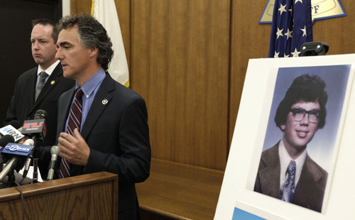 Cook County Sheriff Tom Dart speaks during a news conference accompanied by Detective Jason Moran, Thursday, Sept. 20, 2012 in Chicago, Ill. In an ongoing effort by the Cook County Sheriff's Office to identify the unidentified victims of John Wayne Gacy, the department was able to solve another unrelated cold missing person case. The body of Peoria Illinois native Daniel Raymond Noe, (in photo), who went missing 30 years ago was discovered on Mount Olympus in Utah and evidence has determined his disappearance and death are not connected to Gacy. (AP Photo/M. Spencer Green)