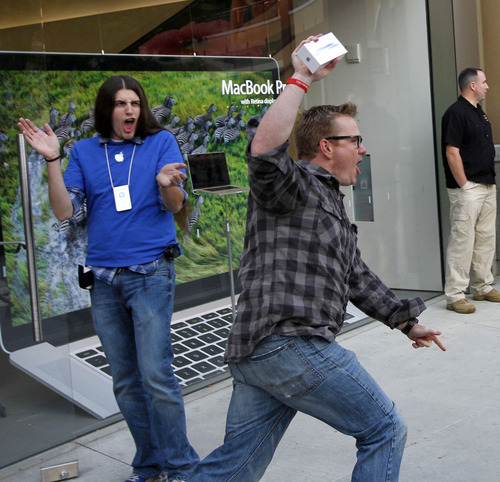 Al Hartmann  |  The Salt Lake Tribune Brad Bacigalupi runs from the Gateway Apple Store with the first iPhone 5 that went on sale at 8 a.m. Friday, Sept. 21 . Many of the first-in-line shoppers waited nearly 24 hours to be the first to buy the new phone.