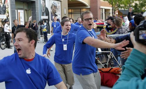 Al Hartmann  |  The Salt Lake Tribune At 7:55 a.m. Apple Store employees give