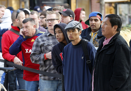 Al Hartmann  |  The Salt Lake Tribune Front of the line buyers wait with anticipation to buy the Apple iPhone 5 that went on sale at 8 a.m. Friday September 21 at the Apple Store at the Gateway in Salt Lake City.