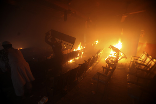 Protesters torch a cinema in Peshawar, Pakistan on Friday, Sept 21, 2012. Tens of thousands protested around the country against an anti-Muslim film after the government encouraged peaceful protests and declared a national holiday ?