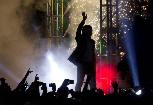 WBO welterweight champion boxer Manny Pacquiao, of the Philippines, waves as fireworks explode behind him during a boxing presentation in Mexico City, Friday, Sept. 21, 2012. Pacquiao and his Mexican challenger Juan Manuel Marquez are promoting their fourth fight, scheduled for Dec. 8, 2012 in Las Vegas. (AP Photo/Christian Palma)