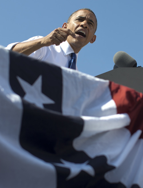 President Barack Obama speaks at a campaign event at  G. Richard Pfitzner Stadium, Friday, Sept. 21, 2012, in Woodbridge, Va. (AP Photo/Carolyn Kaster)