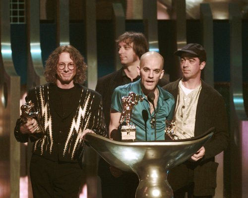 REM acepts the award for Video Vanguard during the 1995 MTV Video Music Awards at Radio City Music Hall in New York Thursday, September 7, 1995.  (AP Photo/ Bebeto Matthews)