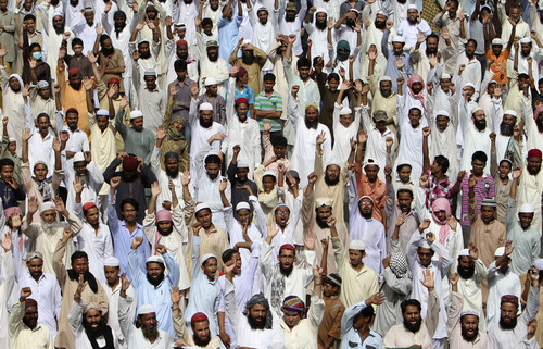 Supporters of Pakistani religious group Ahle Sunnat Wal Jammat shout anti-U.S. slogans during a funeral for a colleague who was killed in Friday's violent protest against an anti-Islam film, Saturday, Sept. 22, 2012 in Karachi, Pakistan. (AP Photo/Fareed Khan)