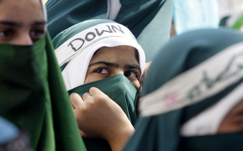 Kashmiri Muslim students participate in a protest rally against an anti-Islam film called