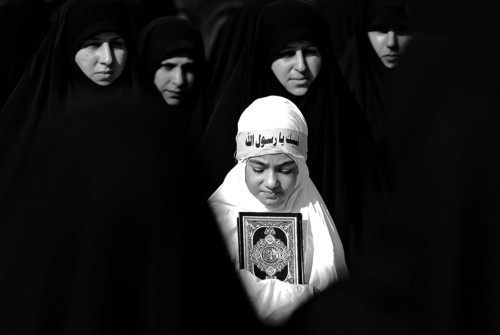 A Lebanese girl holds a copy of the Quran, the Muslim holy book, as she attends a protest about a film ridiculing Islam's Prophet Muhammad in the southern border town of Bint Jbeil, Lebanon, Saturday, Sept. 22, 2012, for the latest in a series of protest rallies organized by the Shiite militant group Hezbollah. Arabic writing on her headband reads