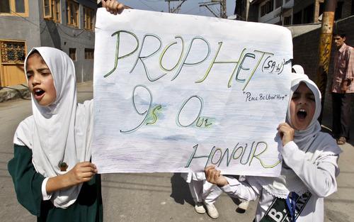 Kashmiri Muslim students shout slogans during a protest rally against an anti-Islam film called