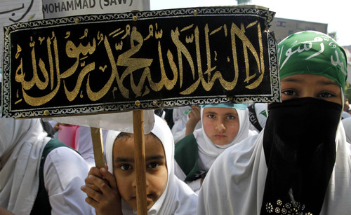 Kashmiri Muslim students hold placards as they participate in a protest rally against an anti-Islam film called