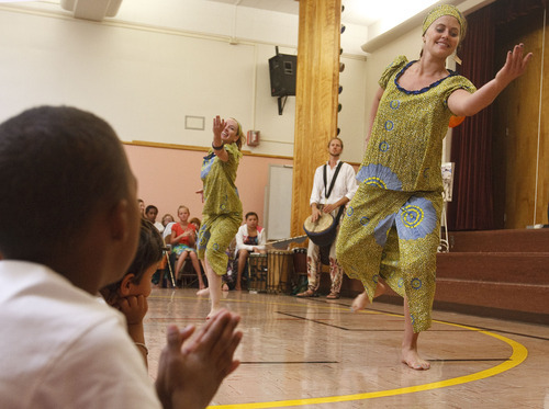 Leah Hogsten  |  The Salt Lake Tribune Drummers and dancers Rosie Banchero (left) and Whitney Hobson (right) keep the African drum beat. Students and teachers at Cottonwood Elementary were treated to dancers and musicians showcasing the culture of Africa as part of the school's Friend to Friend service project for children in the Samburu District of the Rift Valley Province, Kenya, Friday, September 21, 2012. . The goal of the project is for Cottonwood students to make personal connections with the children in Africa.