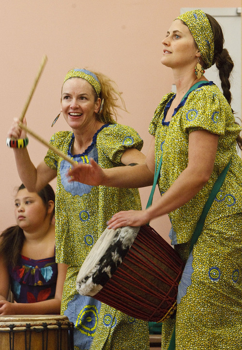 Leah Hogsten     The Salt Lake Tribune Drummers Rosie Banchero (left) and Whitney Hobson (right) keep the African drum beat. Students and teachers at Cottonwood Elementary were treated to dancers and musicians showcasing the culture of Africa as part of the school's Friend to Friend service project for children in the Samburu District of the Rift Valley Province, Kenya, Friday, September 21, 2012. . The goal of the project is for Cottonwood students to make personal connections with the children in Africa.