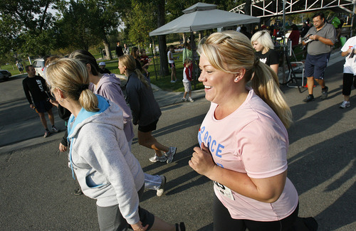 Scott Sommerdorf  |  The Salt Lake Tribune              Author Elissa Wall runs in the 5K run to benefit Holding Out Help, a group that helps people leaving polygamy. Wall is the author of the autobiography