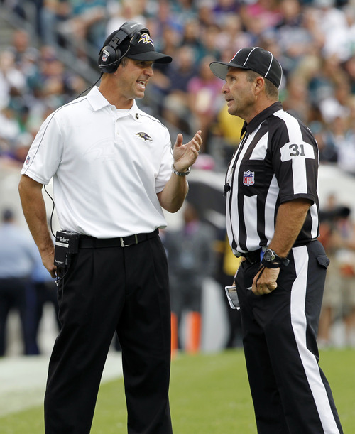 Baltimore Ravens head coach John Harbaugh talks to an offical in the second half of an NFL football game against the Philadelphia Eagles Sunday, Sept. 16, 2012, in Philadelphia. (AP Photo/Mel Evans)