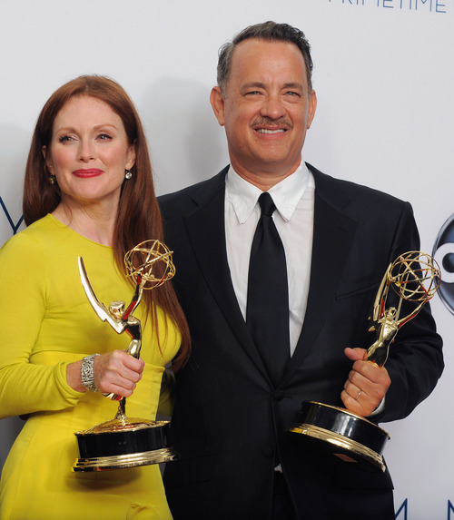 Actress Julianne Moore, left and producer Tom Hanks winner Outstanding Lead Actress In A Miniseries or Movie for 'Game Change', pose backstage at the 64th Primetime Emmy Awards at the Nokia Theatre on Sunday, Sept. 23, 2012, in Los Angeles. (Photo by Jordan Strauss/Invision/AP)