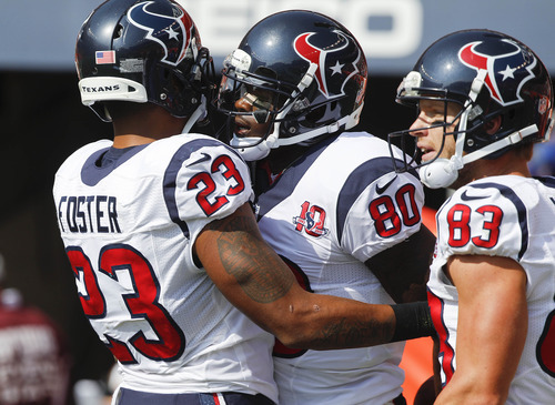 Houston Texans wide receiver Andre Johnson (80) celebrates with running back Arian Foster (23) and wide receiver Kevin Walter (83) after scoring on a touchdown pass against the Denver Broncos in the first quarter of an NFL football game Sunday, Sept. 23, 2012, in Denver. (AP Photo/David Zalubowski)