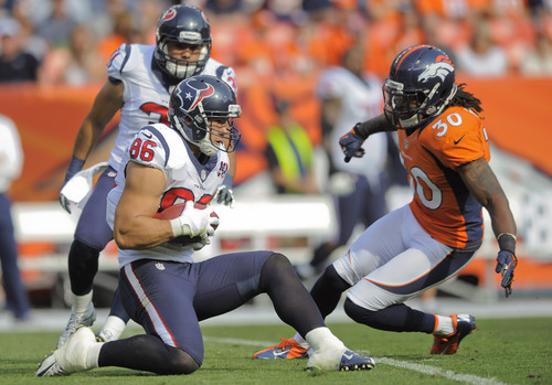 Houston Texans fullback James Casey (86) recovers an onside kick as Denver Broncos free safety David Bruton (30) defends in the third quarter of an NFL football game Sunday, Sept. 23, 2012, in Denver. (AP Photo/Jack Dempsey)