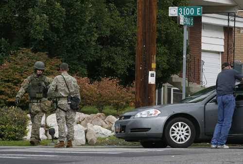 Scott Sommerdorf  |  The Salt Lake Tribune              Unified Police and a bomb squad respond to a report of a man barricaded in his home with possible explosives at 3128 Del Mar in Millcreek, Sunday, September 23, 2012.