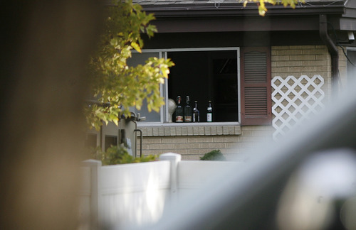 Scott Sommerdorf  |  The Salt Lake Tribune              The window that suspect David Charles Baker has stacked bottles after he had knocked out the screen. Presumably to alert him if officers stormed through the window. Unified Police respond to a report of a man barricaded in his home with possible explosives at 3128 Del Mar in Millcreek, Sunday, September 23, 2012.