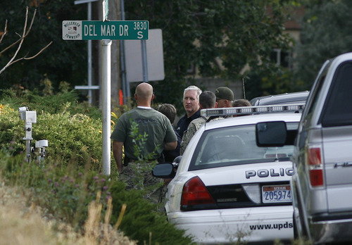 Scott Sommerdorf  |  The Salt Lake Tribune              Sheriff Jim Winder discusses the situation with officers who have responded to a report of a man barricaded in his home with possible explosives at 3128 Del Mar in Millcreek, Sunday, September 23, 2012.