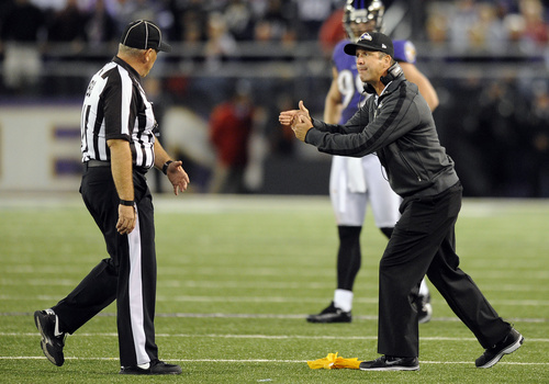 Baltimore Ravens head coach John Harbaugh, right, speaks with head linesman Rodney Russell in the second half of an NFL football game against the New England Patriots in Baltimore, Sunday, Sept. 23, 2012. (AP Photo/Nick Wass)