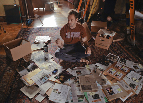 Courtesy photo Sherlock Holmes (Jonny Lee Miller) sifts through evidence in an upcoming episode of
