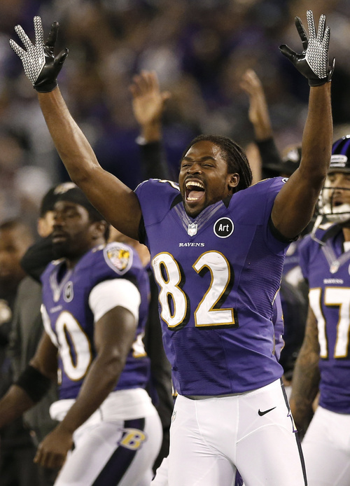 Patrick Semansky | The Associated Press Baltimore receiver Torrey Smith celebrates after kicker Justin Tucker kicked the game-winning field goal to beat the Patriots.