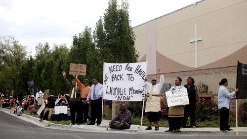 Ashley Detrick     The Salt Lake Tribune Members of the Tongan United Methodist Church in West Valley City protest outside the church on Sunday September 23, 2012.  Members of the West Valley City church protested the temporary removal of their pastor, Rev. Havili Mone. The members are upset that they were not given an explanation for the move and that the replacement pastor locked members out of the church last week.