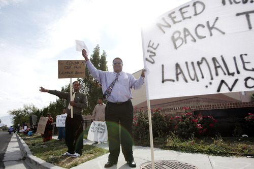 Ashley Detrick     The Salt Lake Tribune Daunibau Lotaki waves to passers by during a protest at the Tongan United Methodist Church on Sunday September 23, 2012.  Members of the West Valley City church protested the temporary removal of their pastor, Rev. Havili Mone. The members are upset that they were not given an explanation for the move and that the replacement pastor locked members out of the church last week.