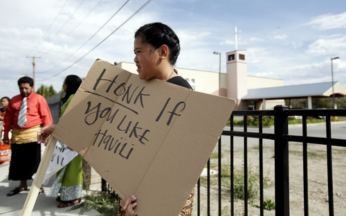 Ashley Detrick     The Salt Lake Tribune Latai Sekeni stands in protest with dozens other members of the Tongan United Methodist Church on Sunday September 23, 2012.  Members of the West Valley City church protested the temporary removal of their pastor, Rev. Havili Mone. The members are upset that they were not given an explanation for the move and that the replacement pastor locked members out of the church last week.