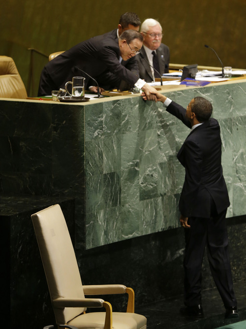President Barack Obama shakes hands with UN Secretary General Ban Ki-Moon before addressing the 67th session of the United Nations General Assembly at the United Nations headquarters, Tuesday, Sept. 25, 2012. (AP Photo/Pablo Martinez Monsivais)